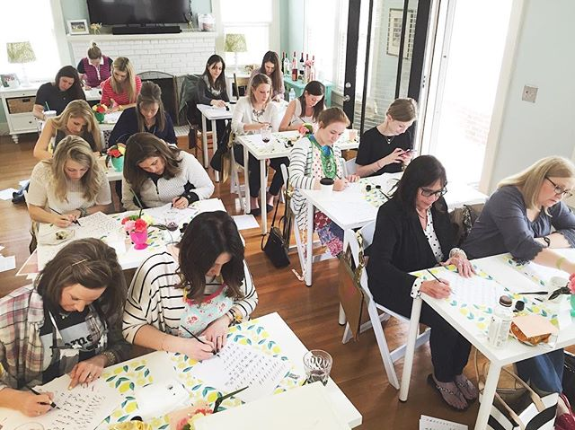 Reminiscing on when our very first modern calligraphy workshop was at @loveofcharacter's HOME years ago. Now she not only has a storefront and an adorable baby girl but has expanded her shop to the space next door, and we have taught hundreds of students in Wichita, Oklahoma, Dallas and online and now have a baby on the way 😭. Could be the hormones but I'm giddy for our next workshop this Saturday @swooziesdallas. Join us before I head out on leave and catch a glimpse of that bump 🤰🏼 she's poppin #caddycornerworkshop