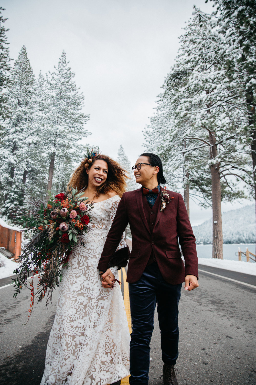 kiki & porntep - This elopement was the most beautiful mix of cold winter vibes and warm family energy. The day couldn't have been more magical. We started the day at a gorgeous house with a stunning view of the freshly snowed on Sierras. My bride literally drove herself (& me!) to the ceremony location in her Subaru, reciting her vows in her head. The colors outside were popping and vibrant against the white of the weather. We got to adventure afterward and pop some Champagne, jam out and off road into the wilderness to take some more intimate photos. I made lifelong friends and we had such a great time. I'm grateful to have been such a huge part of their special day. ♥️