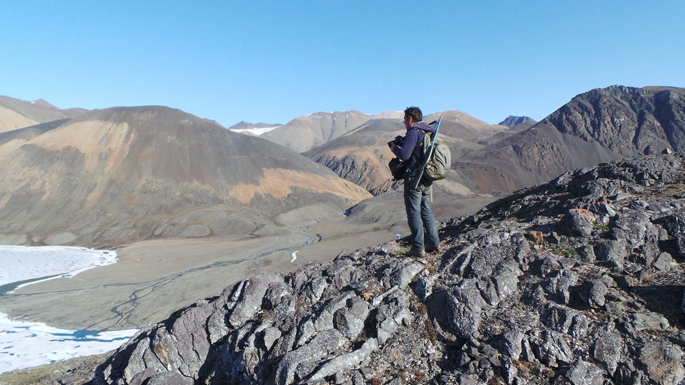 Dennis Sarrazin on a ridge on the north coast of Ellesmere Island