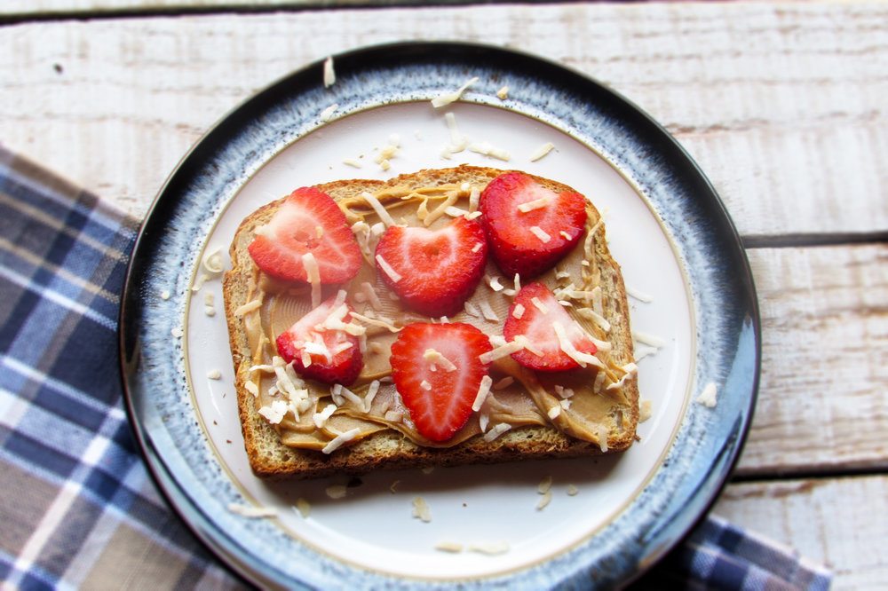 Peanut butter, sliced strawberries and toasted coconut