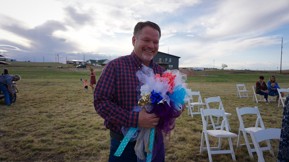 My father holding the temporary bouquet made for the wedding rehearsal. Isn't he beautiful?