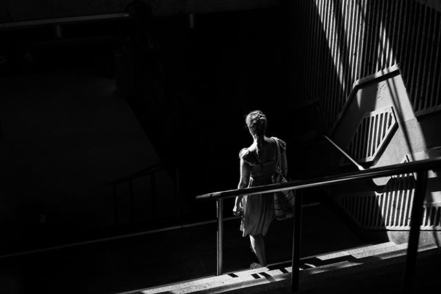 Descent. August 18, 2018. Montreal. . . . . . . . . . #shadow #contrast #light #staircase #architecture #metso #subway #sun #triangles #photographer #blackandwhite #plackandwhitephotography #fanho #black #descent #bublictransport #montreal #summer #woman #girl #art #lightbeme #urban #filmlike #mtl