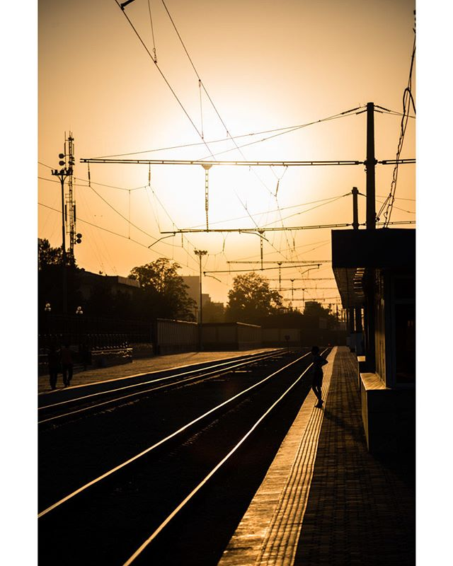 Waiting for the night train. September 6, 2018. Samarkand, Uzbekistan. . . . . . . . . . #train #travel #uzbekistan #samarkand #sunset #contrast #waiting #travelphotography #sun #trainstation #powerlines #lines #rail #waiting #summer #art #flare #overnight #photographer