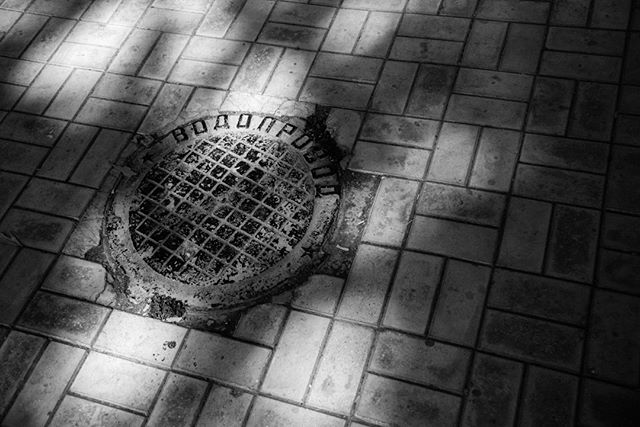 Manhole. August 31, 2018. Tashkent. . . . . . . . . . #soviet #uzbekistan #tashkent #shadow #tile #sidewalk #sun #manhole #cyrilic #russian #uzbek #travel #urban #blackandwhite #contrast #star #travelphotography #photographer #art #light #sun #warm #square #filmlike