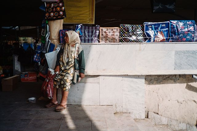 Chorsu Bazaar. September 4, 2018. Tashkent, Uzbekistan. . . . . . . . . . #Bazaar #market #uzbekistan #streetphotography #filmisnotdead #Film #filmphotography #color #tashkent #travel #travelphotography #woman #grandma #sale #asia #waiting #sun #olympusxa #vista #35mm #adventure