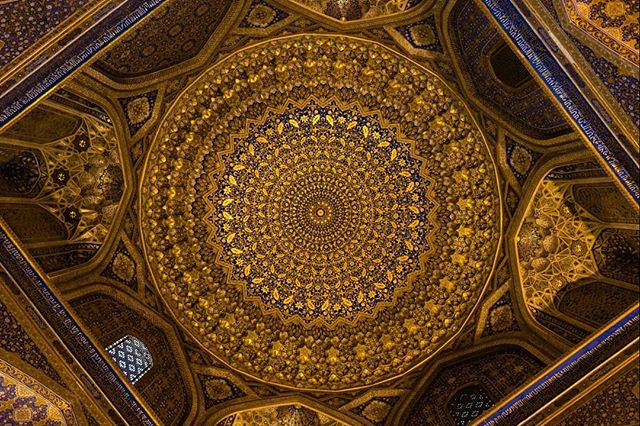 Eye of the sun. The roof of the Sherdor Madrasa. September 6, 2018. Samarkand, Uzbekistan. . . . . . . . . . #travelphotography #adventure #history #architecturephotography #geometry #Uzbekistan #asia #travel #architecture #gold #scroll #art #ancient #culture #photography #shapes #roof #decoration #lavish #world #religion #window #nikon #geographic #craft #traditional #paint
