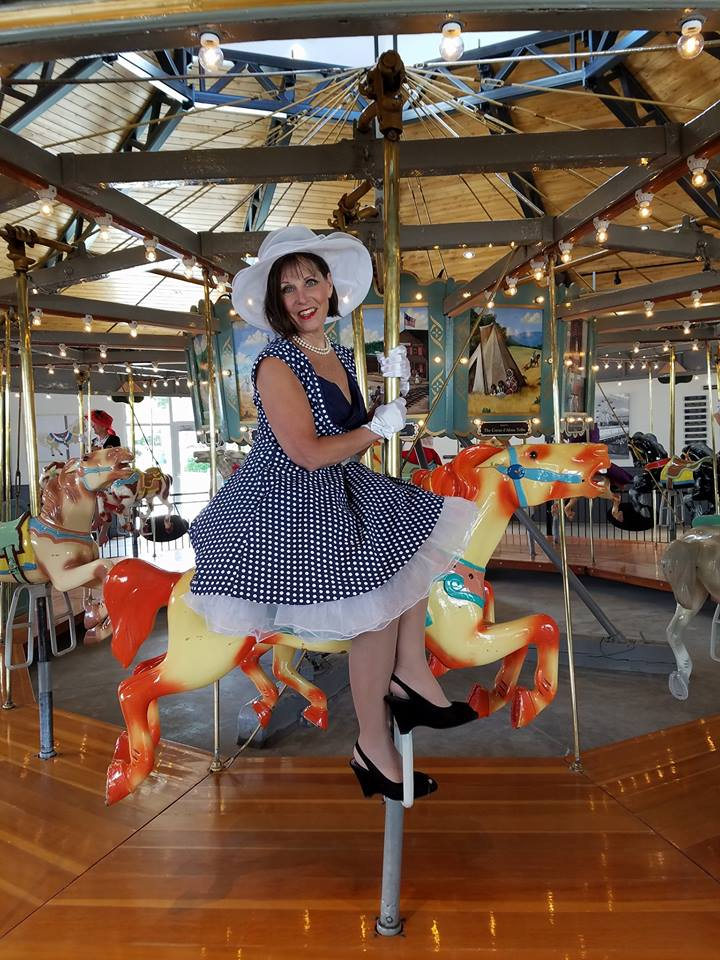 Diva Diane enjoying her carousel ride.