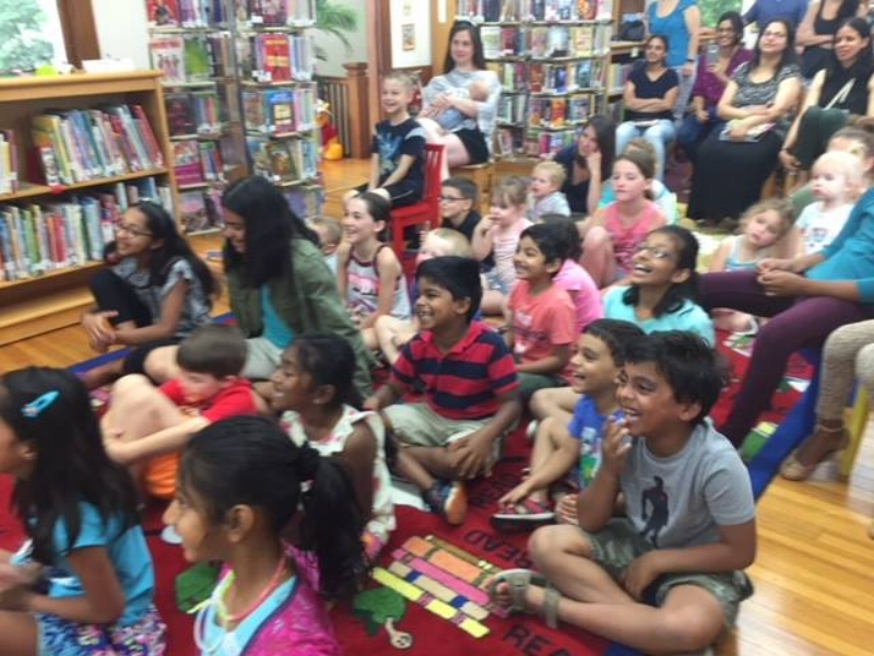 The kids at Crosswicks Library watching Dr. Zing-Zong.
