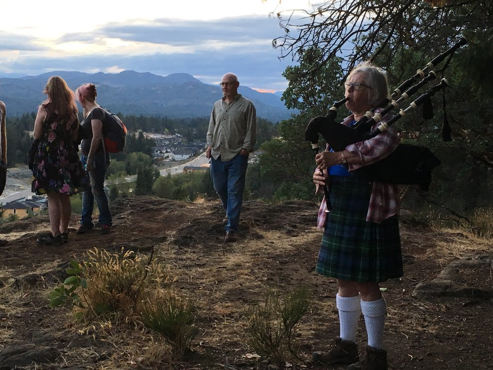 A magical sunset with Bagpiper Barb and Save Linley's Hidden Ridge supporters