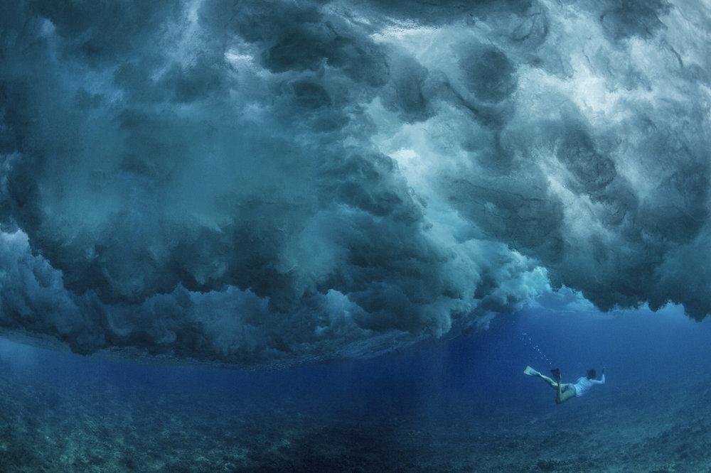Cristina, diving under the big waves of Oahu.  Photo by Paul Nicklen