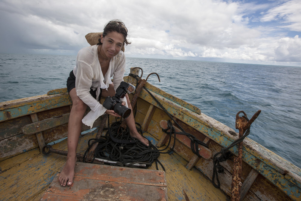 Cristina working on a fishing vessel off the Abrohlos Reef in Brazil, Photo by Paul Nicklen