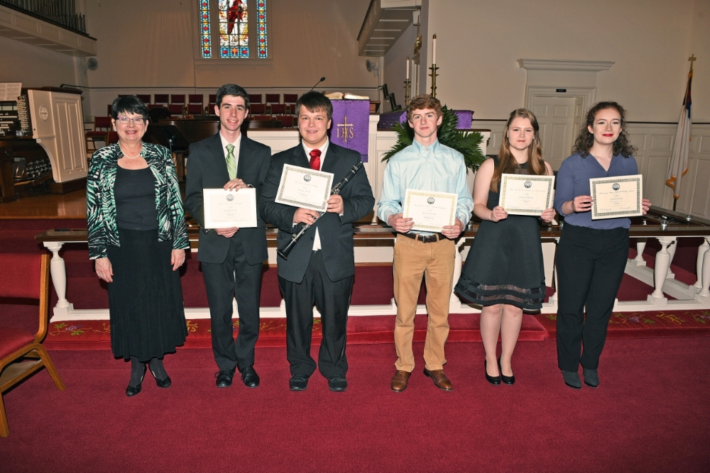 From left to right: Janet Sump,  Scholarship Committee Chair ; Elijah Wyatt, Clarinet,  Jay Craven Clarinet Scholarship ; Spencer Elliott, Saxophone,  Dorothy Martin Scholarship (given by Dr. Jeannette Martin) ; Caitlin Brown, Vocal,  Swaity Scholarship and Admiral and Mrs. Vance (Charlynne) Fry Merit Scholarship ; Juliette Blais, Cello,  Chattanooga Music Club Scholarship and Fletcher Bright String Award ; David Schultz, Organ,  Edwin LeMare Organ Scholarship (given by Mr. and Mrs. Jim (Sharon) Bailiff)