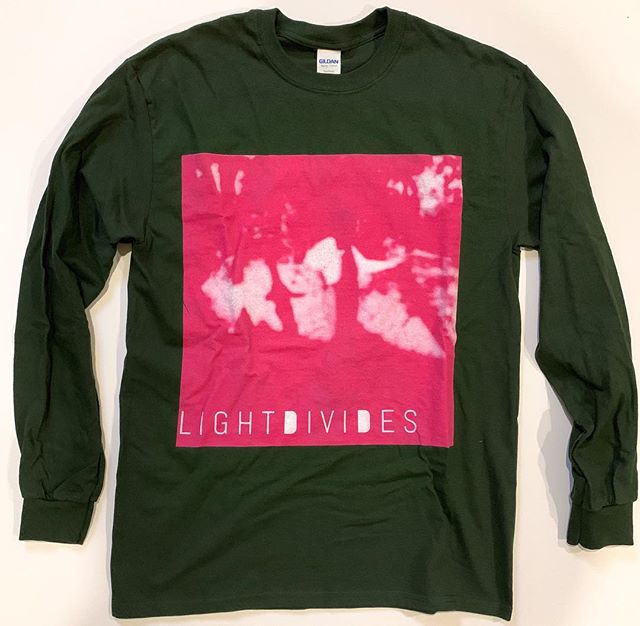 """Green Tee"" long sleeve shirt available now in our store! www.LightDivides.band/store............................................. •design by @salma_ali_writes .......................................................................... #Green #Tee #Longsleeve #Merch #Apparel #LightDivides #Pink #Music #Design"