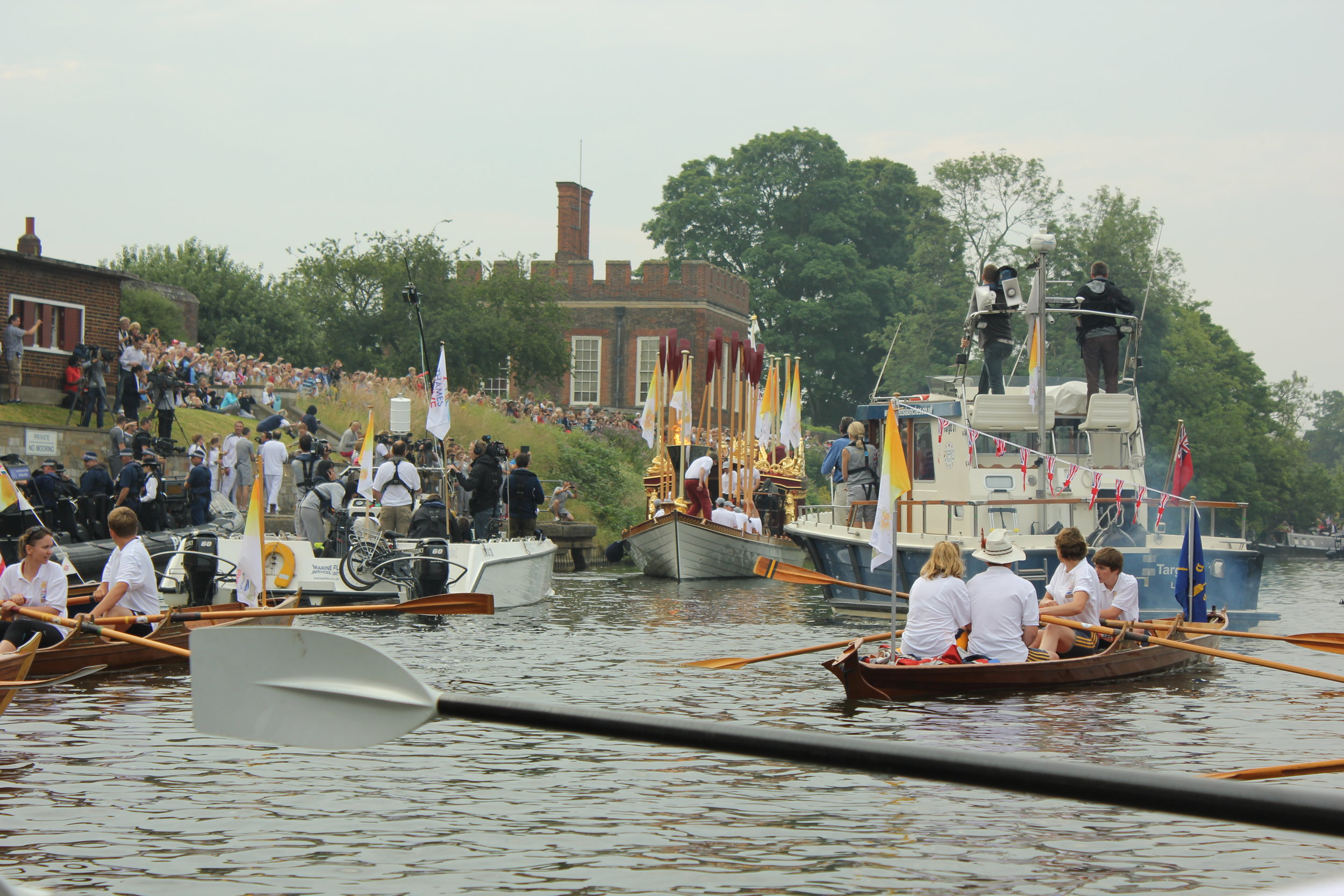 Rowing with the Olympic Torch