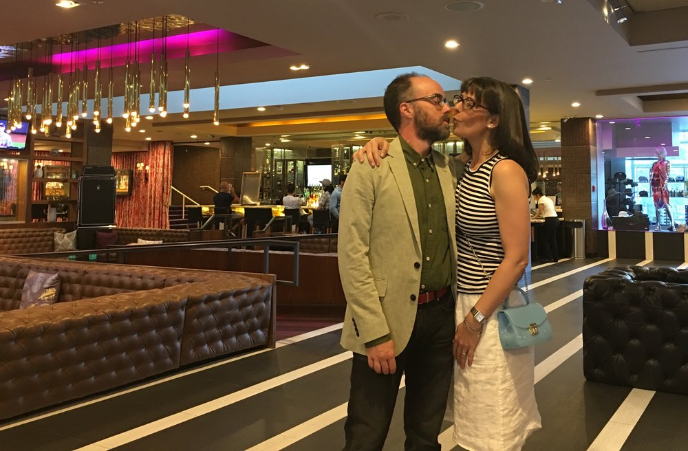 Making out in the lobby.
