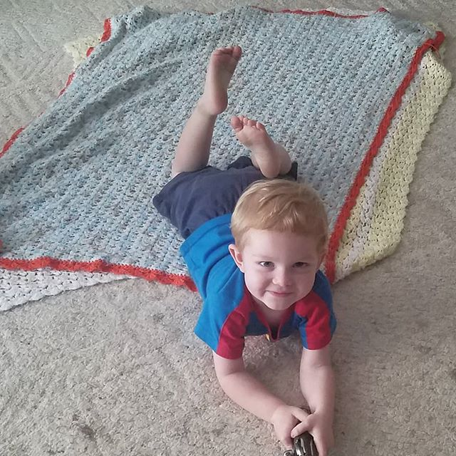 That feeling you get when your son still loves his handmade baby blanket #myheartismelting . . . #bestfeeling #littlecutie #handmadebabyblanket #shellsblanket #crochetblanket #tripleacrochet #crochetgifts #handmadegifts #homelife #lovemykids #crochetmama #mischievious #toddler #orange . . . . . #crochetaddict #yarn #blanket #babygift #babyshowergift #babycrochet #lionbrandyarn #yarnlover #giftideas #babyboy #smallbusiness #craft