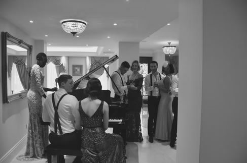 Guests by the grand piano.