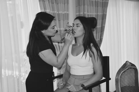 Model Radmilla getting her make-up done.