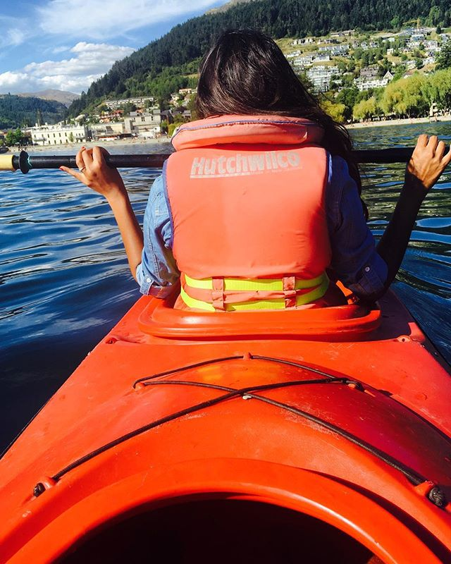 Enjoying the sun in Queenstown, New Zealand. Kayaking is a great alternative to tourist traps! More practical tips in the frugal travel series at frugalhackers.com