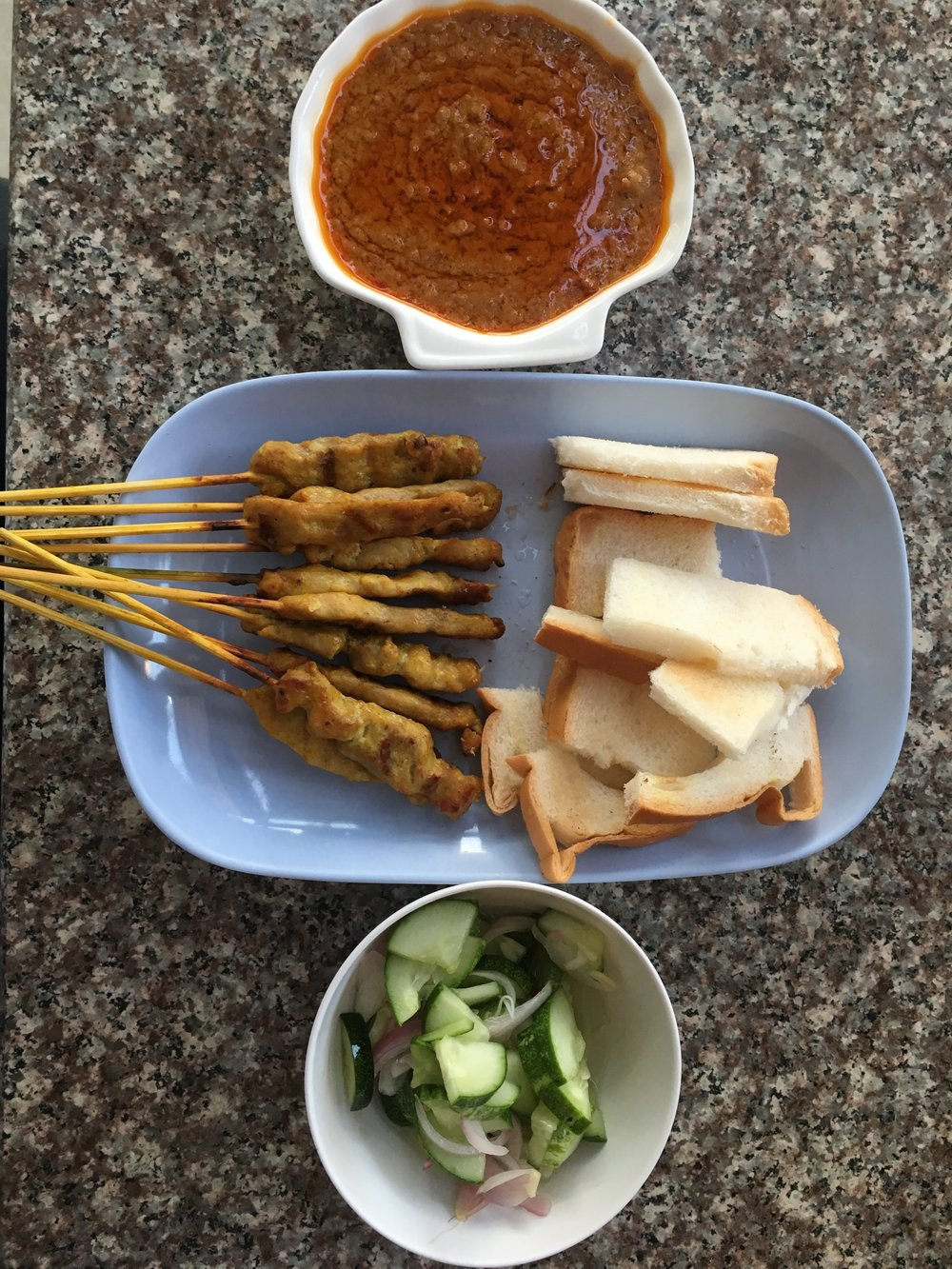 Satay chicken with pickled cucumber salad at Sa la van restaurant, Vientiane. Find it!