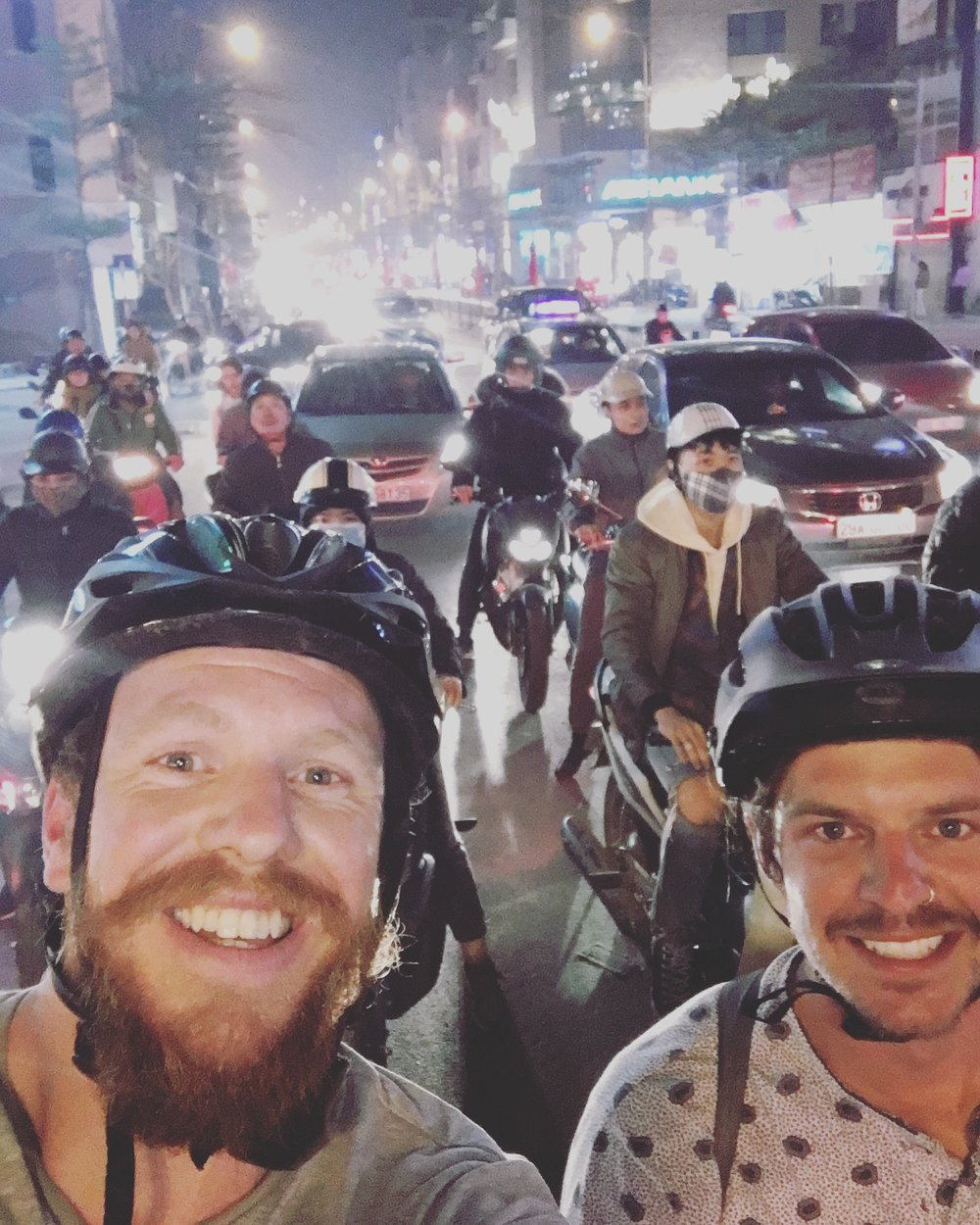 Christian and I getting in and amongst it,riding into Hanoi.