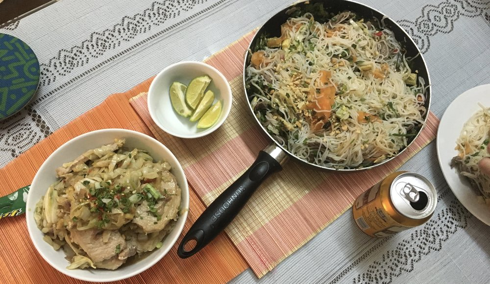 Seared pork striploin with sautéed garlic cabbage and shallots  Marinated beef noodles with veggies, lime, coriander and peanut.