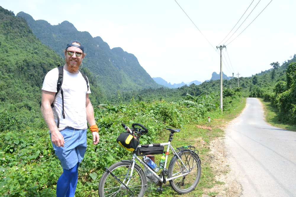 Riding through the incredible scenery of Phong Nha on my way to the Botanical Gardens