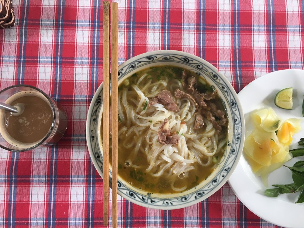 Homestay breakfast of Phở and Vietnamese coffee, with condensed milk