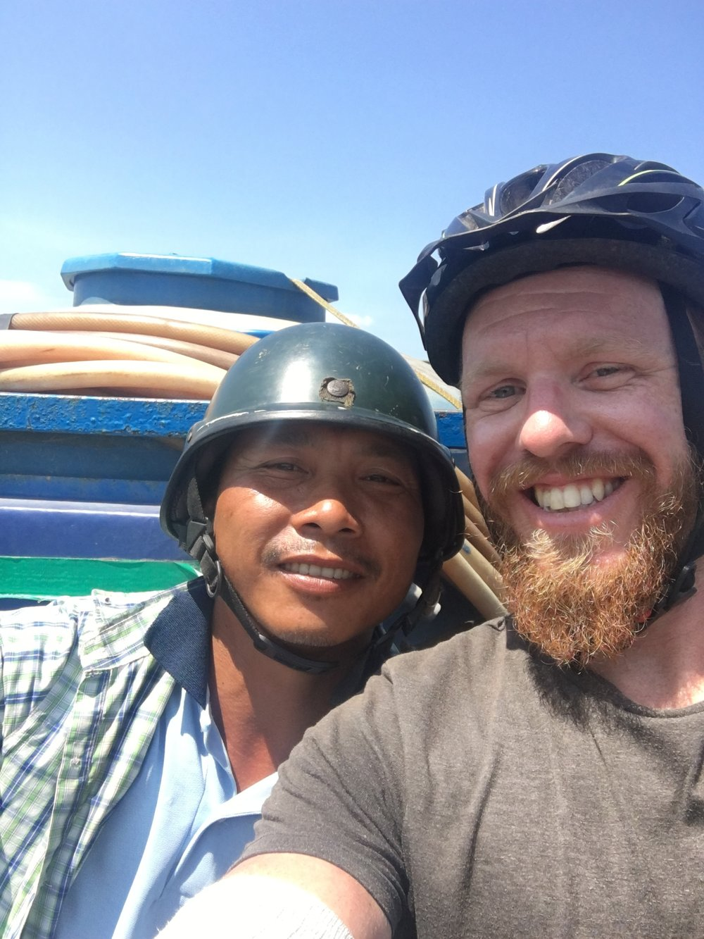 My Vietnamese friend who stopped to watch me pump up my tube and then escort 5 KM down the road and until he waved me on and turned off.