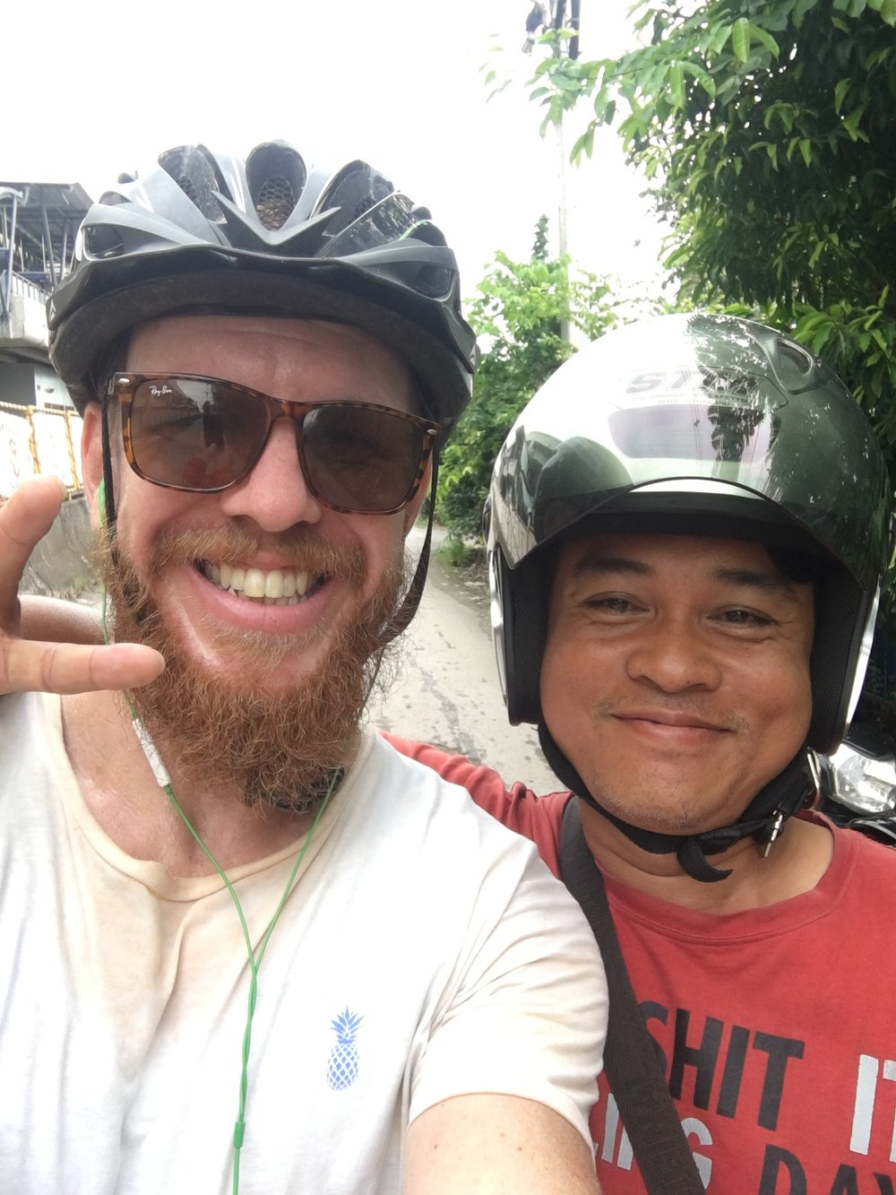 Friendly guy on a back street in BKK. He guided me through a very large puddle, which, if I'd tried to cycle through on my own, would have ended in complete and utter failure.