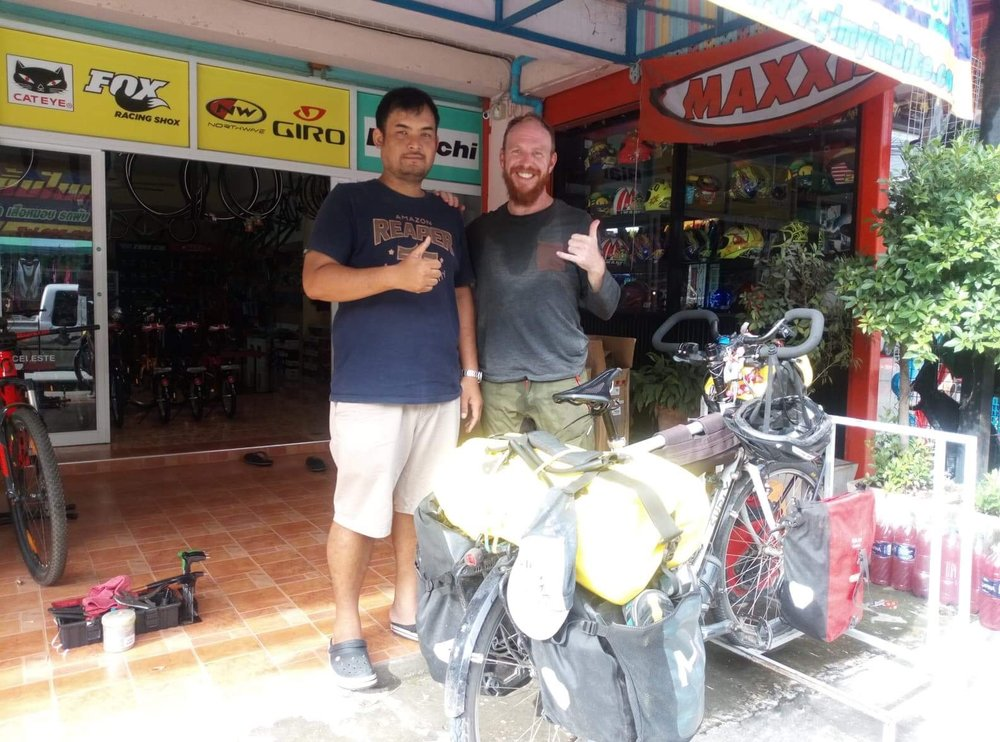 Paradon, the bike shop owner and I in Nakhonsawan