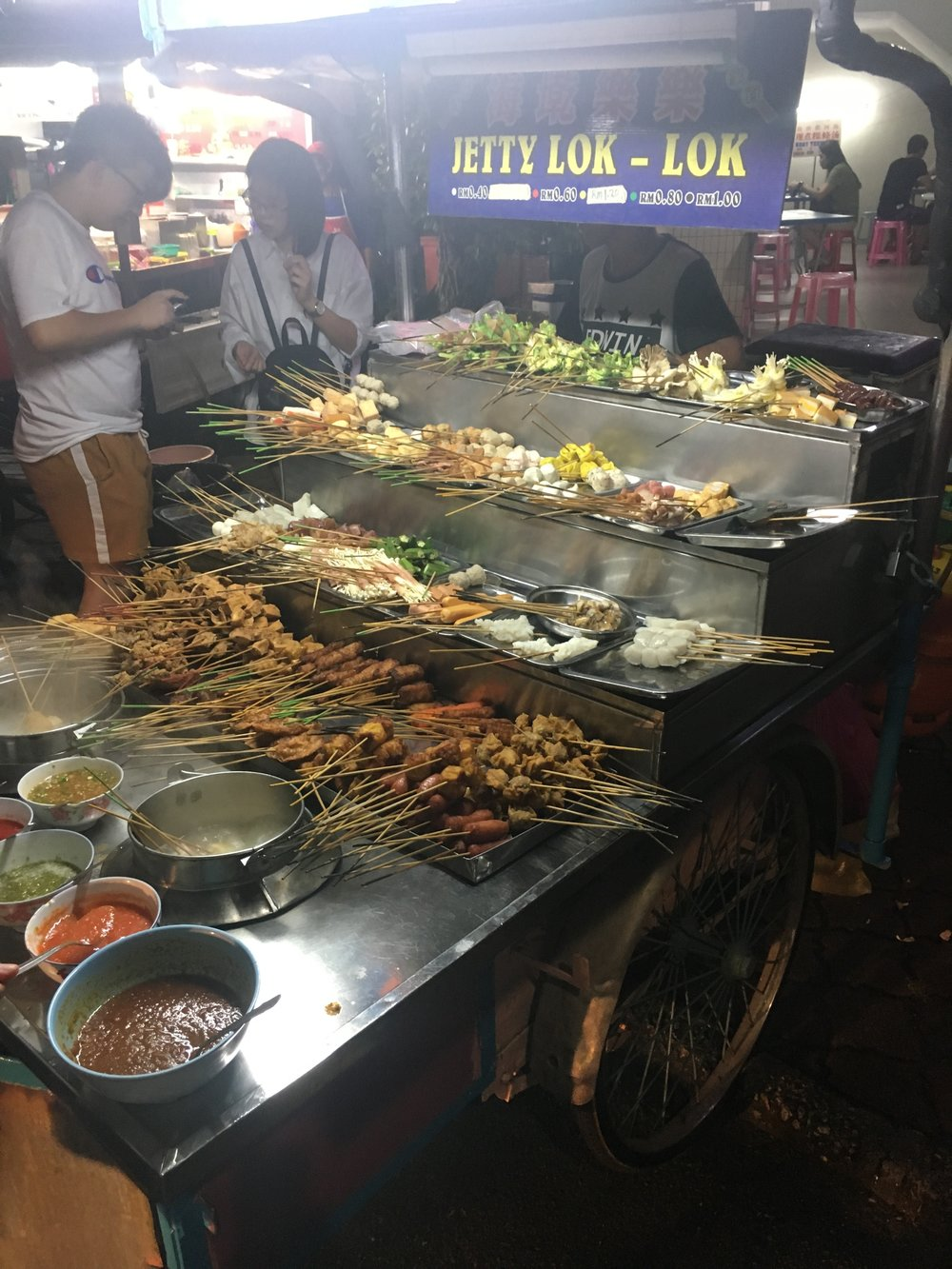 LOK LOK street stall with their huge array of skewered ingredients and many dips