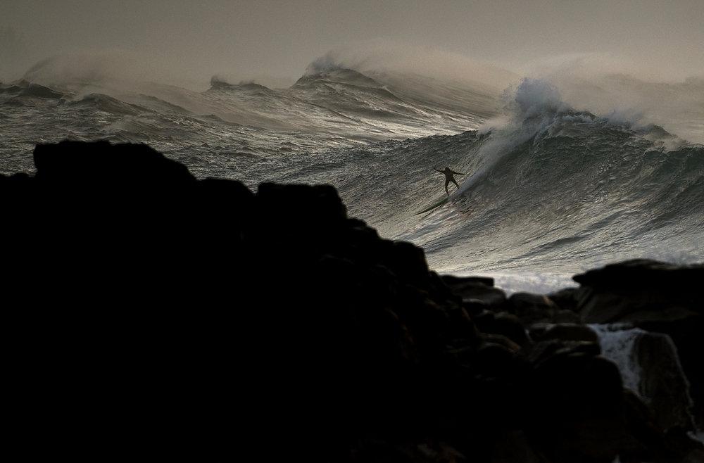 Erich Schlegel_Surfers Tackle 20-foot Waves at Waimea Bay.jpg