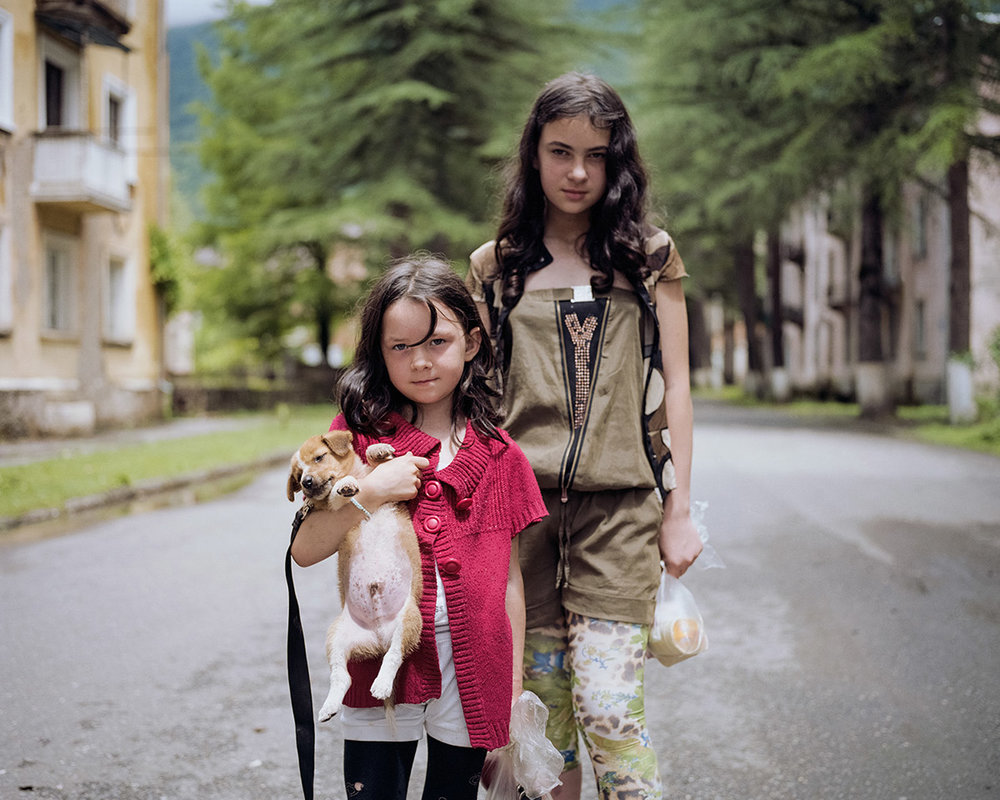 MariaGruzdeva_Sisters Elana and Alesia holding a puppy named Marsik.jpg