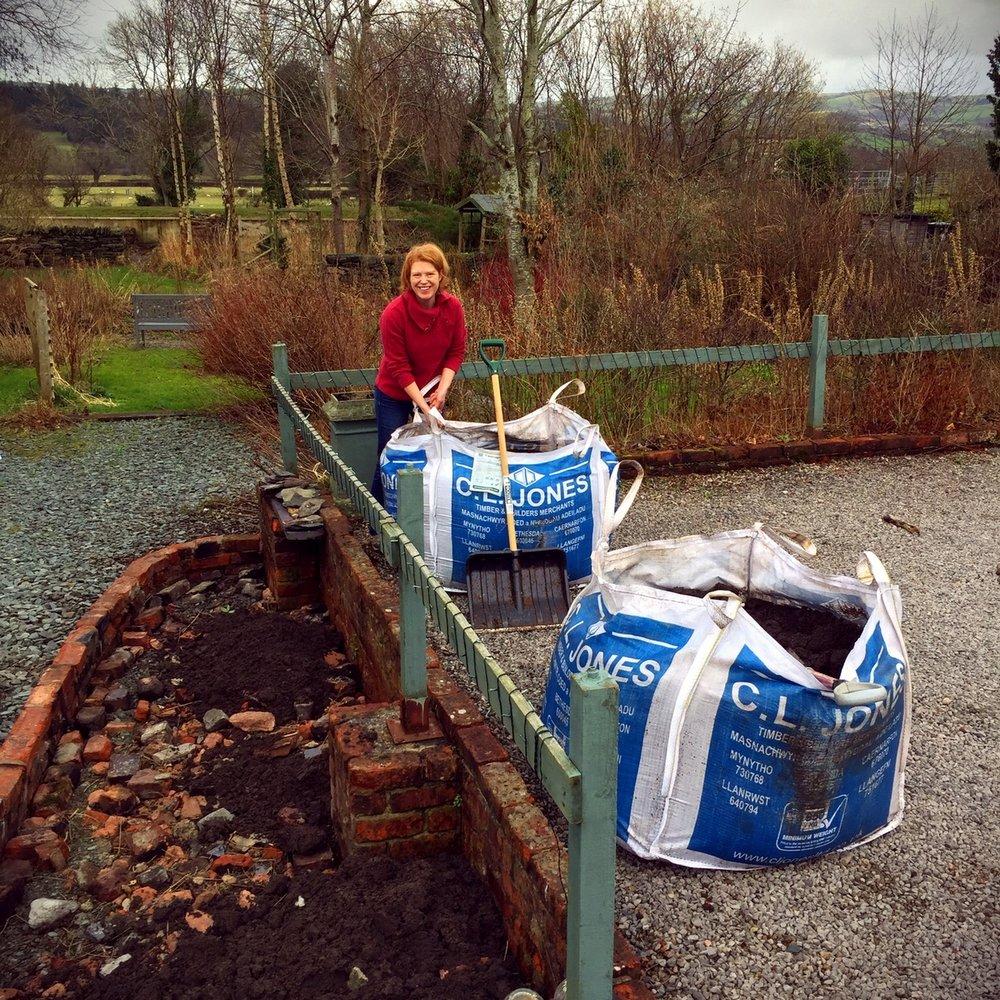 Shovelling two tonnes of topsoil.....