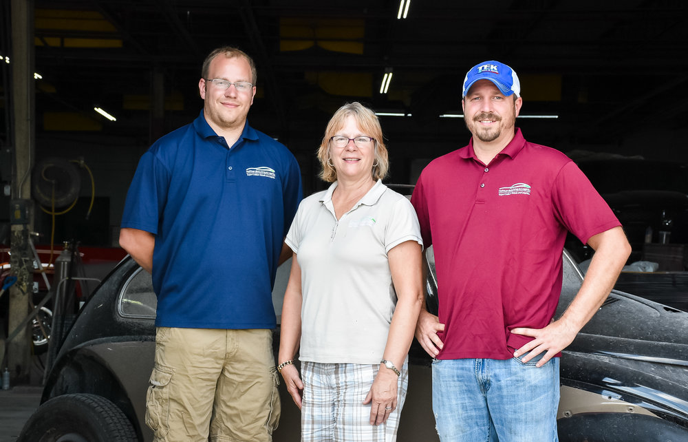 Left to right, Adam, Kim and Aaron Martin of Hoffman Body Shop and Graphics.
