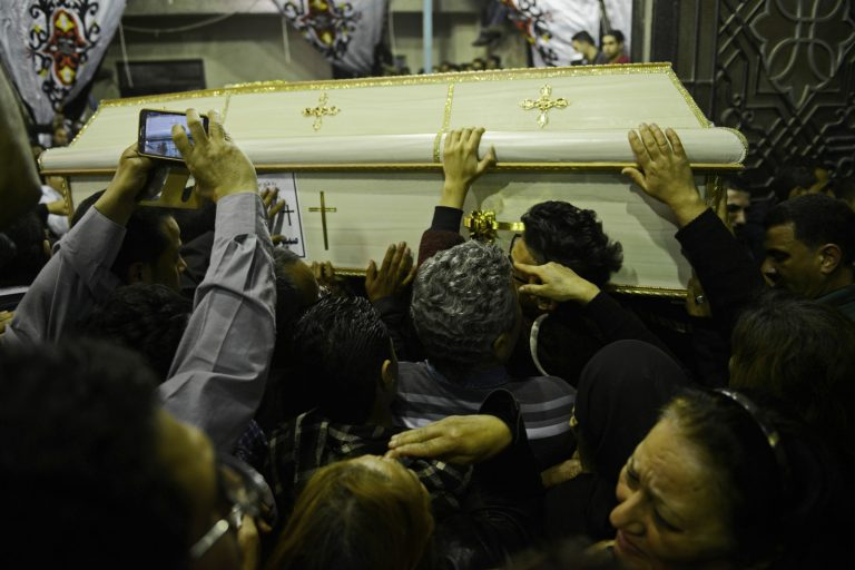 Family members and friends carry a coffin of one of the victims at the funeral inside Saint George church in Tanta on April 9, 2017 (photo by Jonathan Rashad).