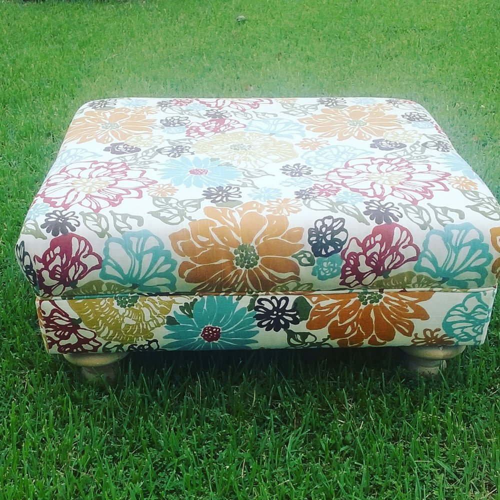 My very first upholstered ottoman. I took a class and we built the frame and put on upholstered it frame scratch.