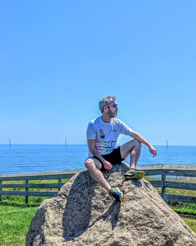 Just chilling on this beaut of a glacial deposit with the first offshore windfarm in the US in the background. Taking a break from our little moped tour. #moped  #blockisland #yimby