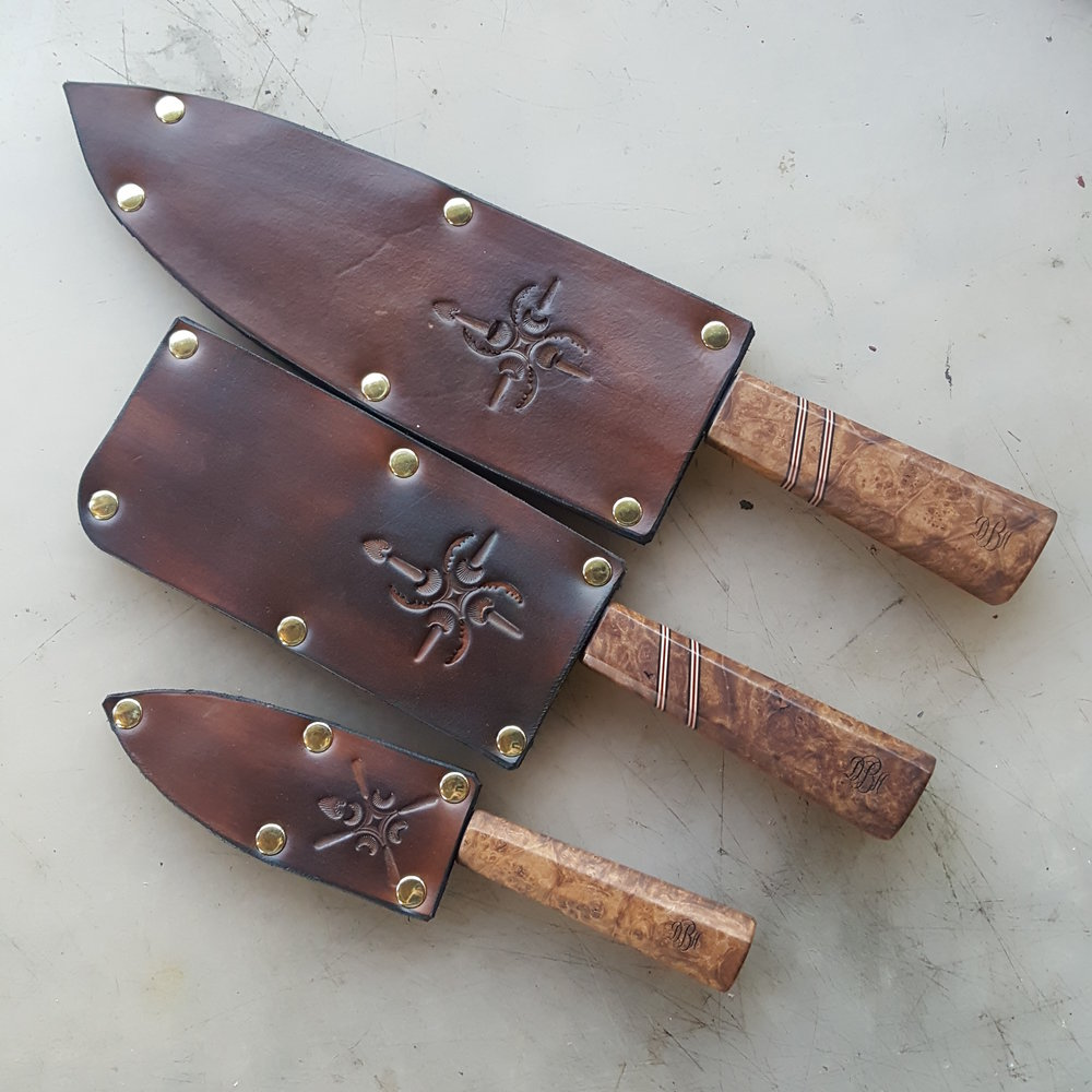 Custom chef's knife set, carbon steel blades with maple burl handles, leather sheath work. Derick Kemper - damselflyforge.com.jpg