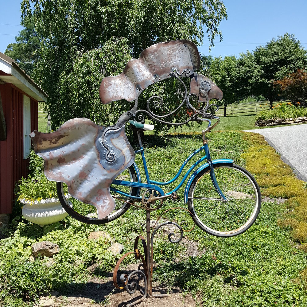 A woman needs a man like a fish needs a bicycle. sculpture by Derick Kemper.jpg