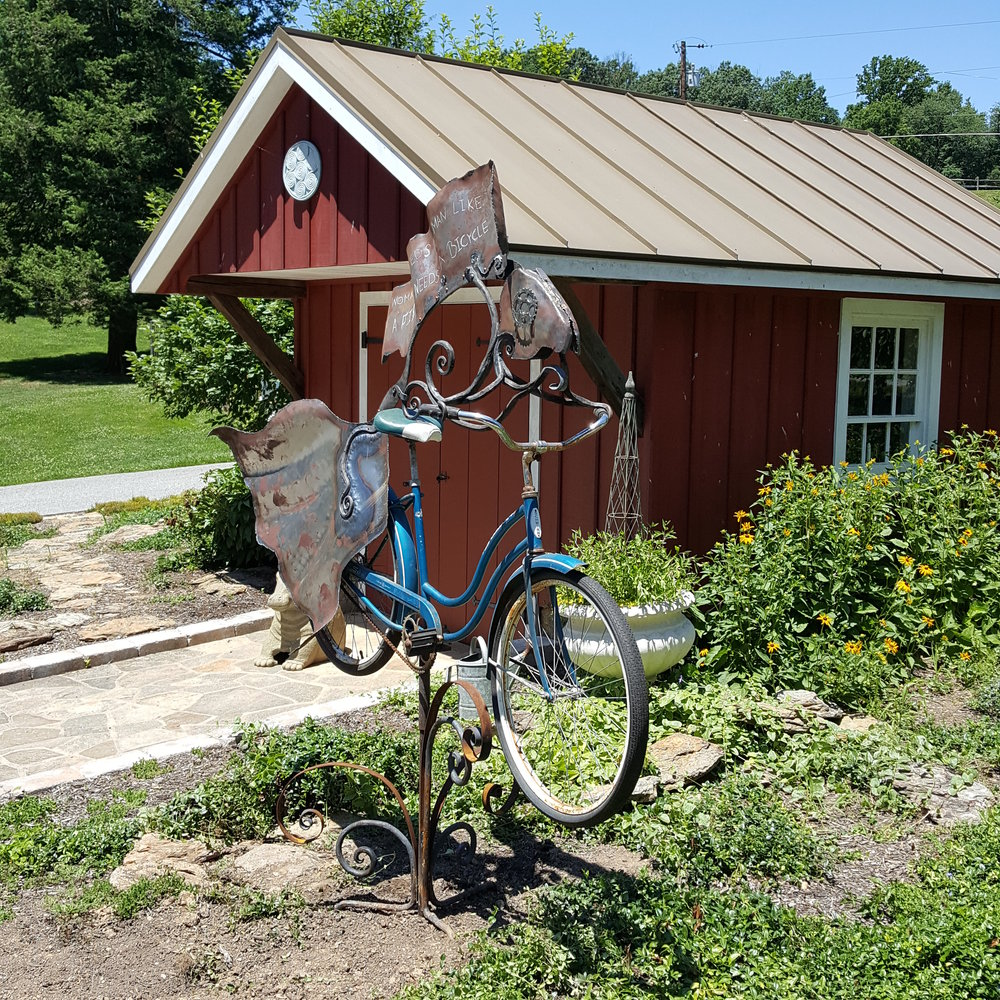 A woman needs a man like a fish needs a bicycle. sculpture by Derick Kemper -damselflyforge.com.jpg