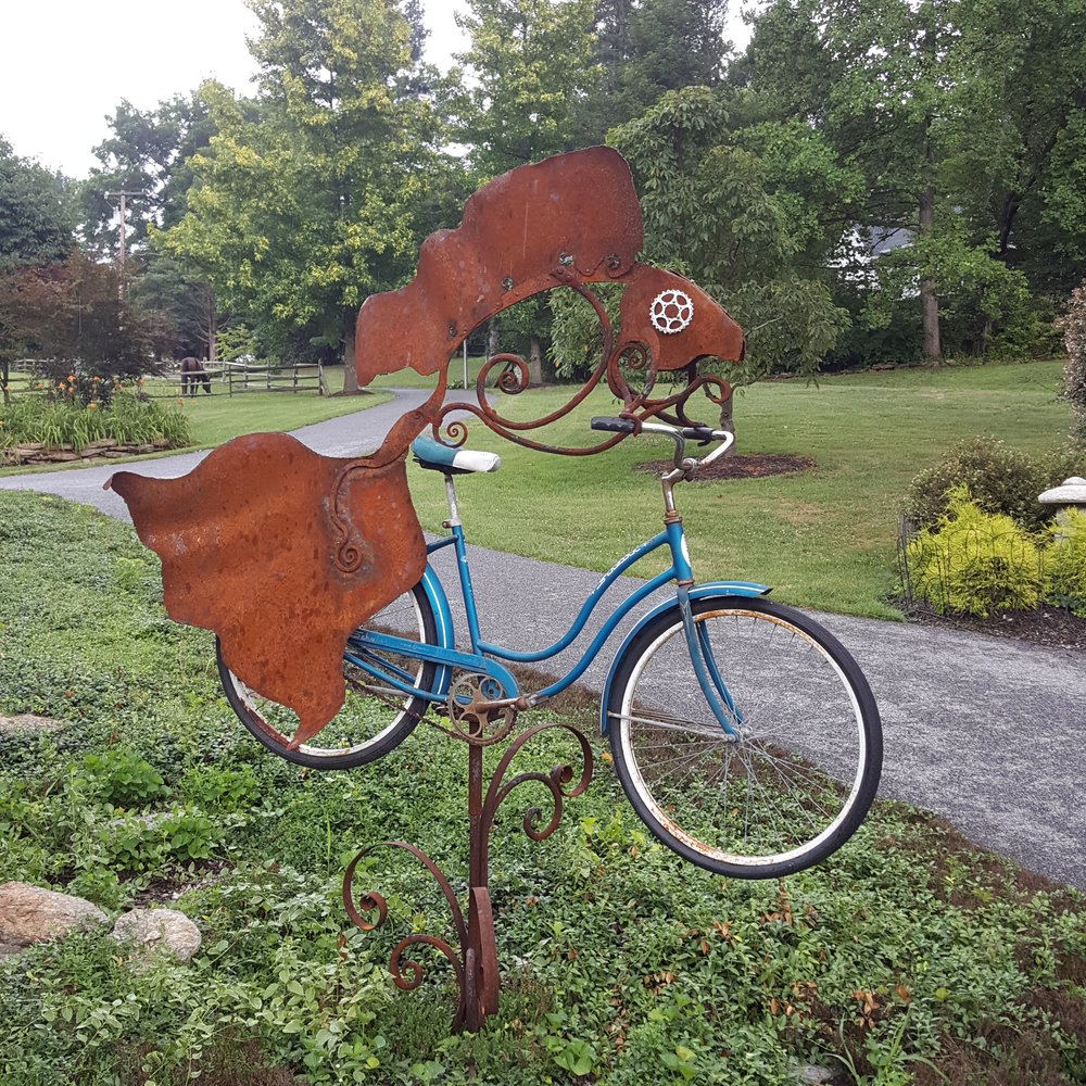 A woman needs a man like a fish needs a bicycle. with completed patina sculpture by Derick Kemper - damselflyforge.com.jpg