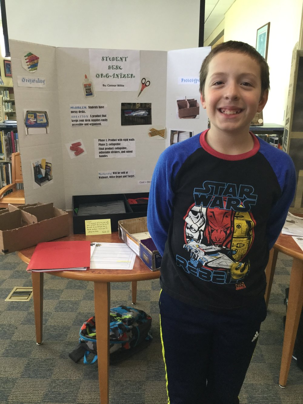 Connor Witte and his school desk organizer.