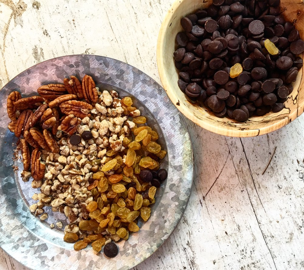 Chocolate enters stage left - Take the nuts and raisins darker with some dark or semisweet chocolate.1/2 cup chocolate chips and 1/2 cup pan-toasted nuts.