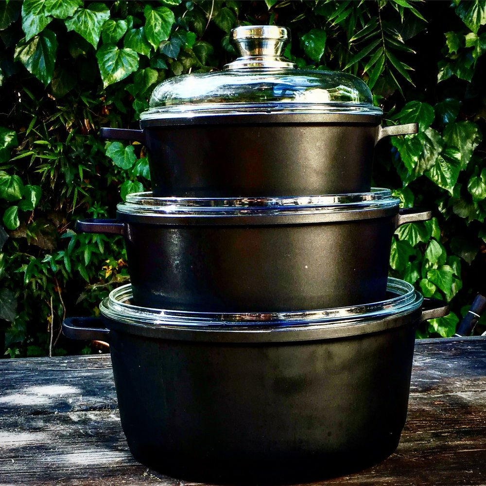 At the bottom of this stack is the EuroCAST 7 quart Dutch oven, which, due to European-to-US measurement translations, actually holds about 7.5 quarts. The middle one is our 5 quart Dutch oven. What's that thing on the top then? It's the EuroCAST 3 quart sauce pan. Beautiful to behold, easy to clean, and all deploying a cast technology lighter than cast iron.