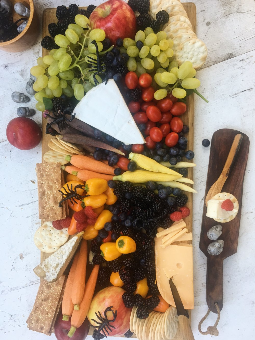 A classic cheese board full of delights. Be generous. Even a scorpion or two makes for a little variety (just kidding ... boo!)