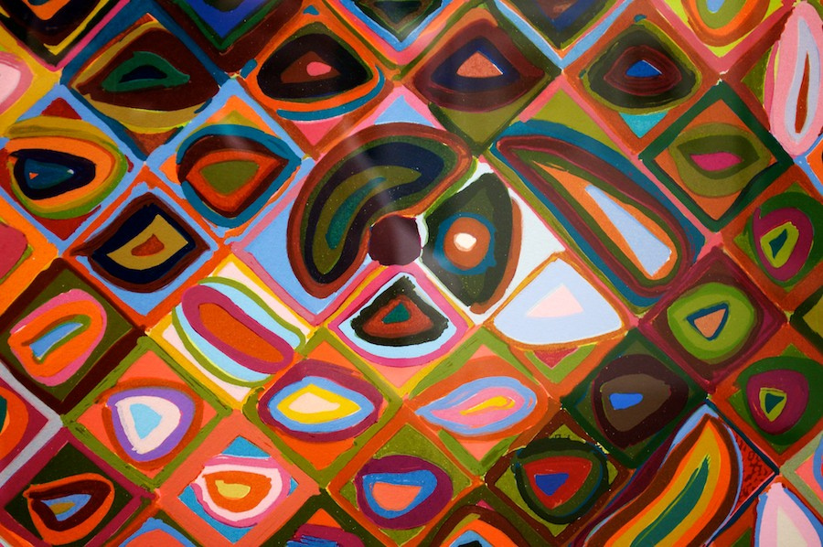 I see pickle, avocado, sausage, pie slices. But really, this is just a close-up picture of a painting by Chuck Close called  James. Life is perspective, baby.