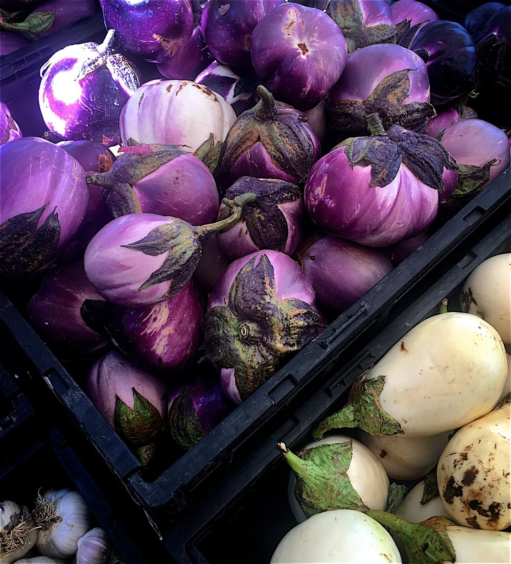 For the vegetarians among you, pick up some beautiful eggplants at the market where the quality is best, and improvise with thick slices and your custom seasoning.