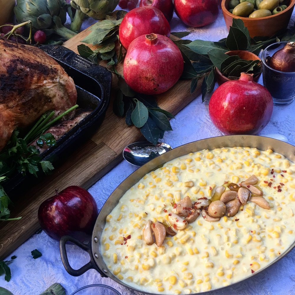 Yes, that's creamed corn topped with garlic confit. As a regular reader of our recipes, you know all about garlic confit.